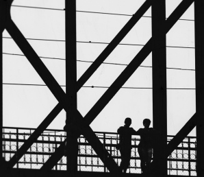 Two boys on a bridge