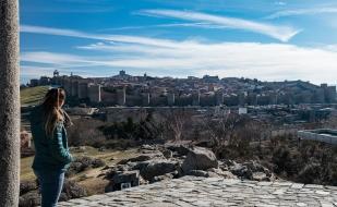 Hannah gazing at the walls of Avila .